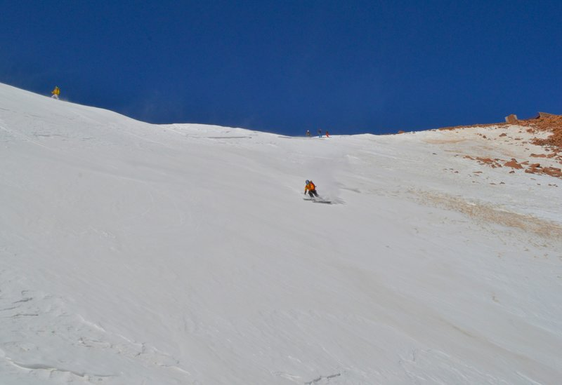 Dropping in off the summit.