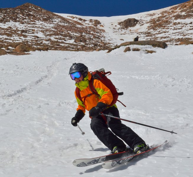 Skiing the lower gully with the upper bowl in the background.