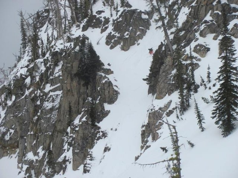 "Skiing the ""Beast Chute"" in Lick Creek Range, just below the crux.  Note the ""shark fins"" in the exit."
