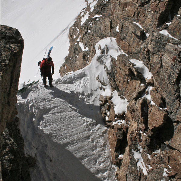 Ryan N. looking down a tracked out couloir.