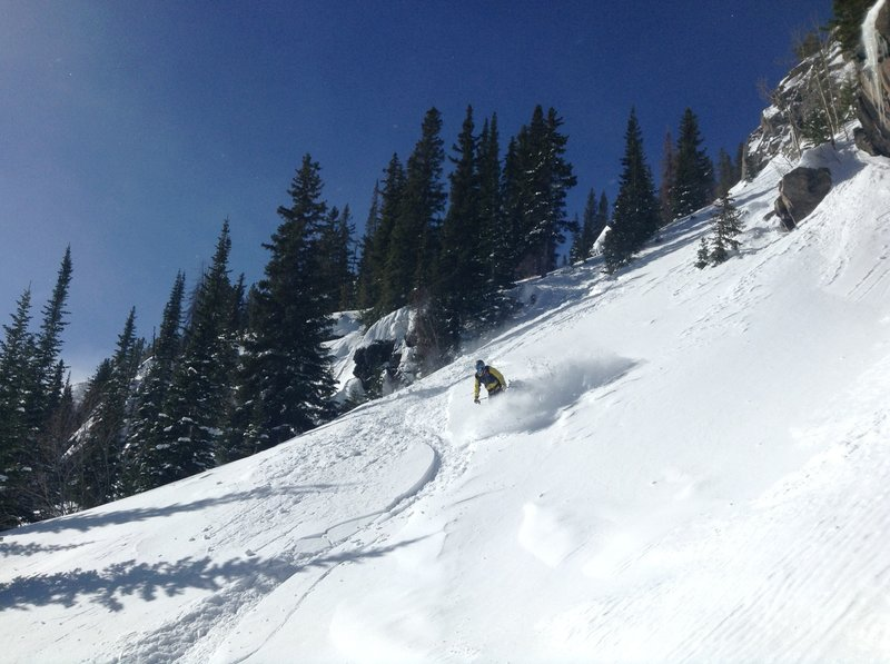 Nick finding the good stuff near the bottom of the terrain park. See that cliff to his (skier's) left? Stick close to it.