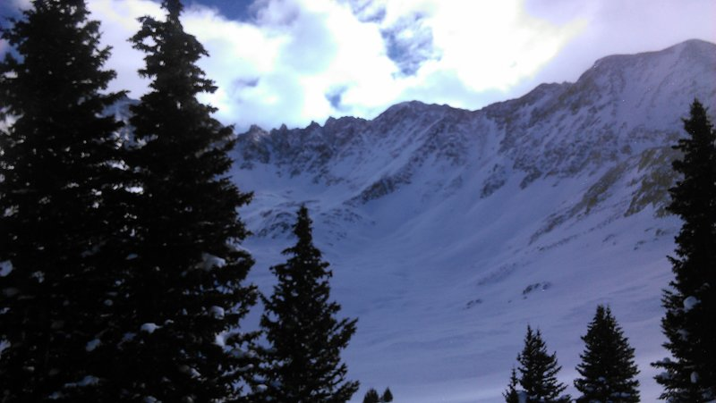 The view of Mayflower Gulch on a descent near tree line. This is the ridgeline connecting Atlantic Peak to Fletcher Mountain at the head of the valley.