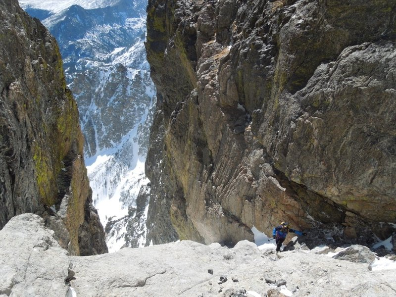 Looking for a rappel anchor in the crux of Dead Elk.