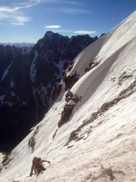 Climbers in the top snowfield of Bell Cord.