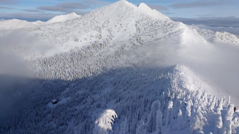 Upper section of the route showing Ymir Backcountry Ski Lodge in lower left and traverse left to ascent ridge.