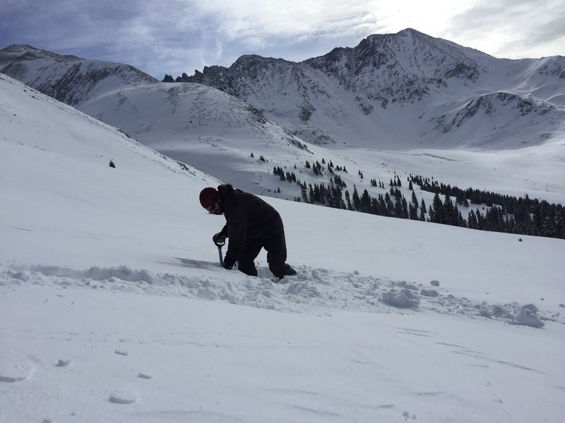 A savvy skier checks the snow conditions near Atlantic Peak.