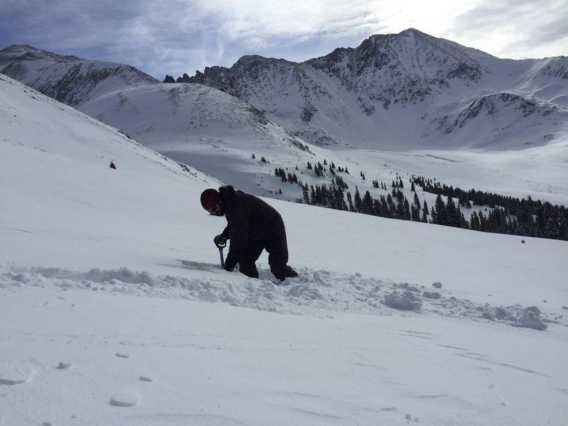 A savvy skier checks the snow conditions near Atlantic Peak.