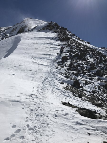Once you get above the scree, another obvious staircase takes you up to the entrance to the Y Chutes. Cut right about 3/4 of the way up the photo where the tongue of snow makes it most of the way across the rocks.
