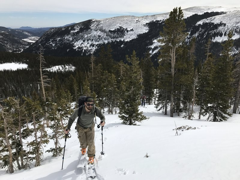 Trudging up the ridge through wet spring snow. Way in the background, on the left side, sits a few of Boulder's foothills; Sanitas, Flagstaff, and Green Mountain.