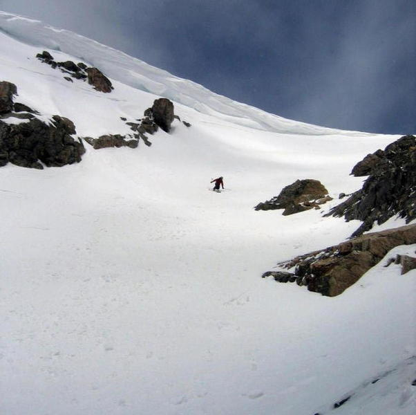 Dropping into the Corral Couloir on a May, 2007 descent with the cornice near its maximum instability. Photo by Eli Helmuth.