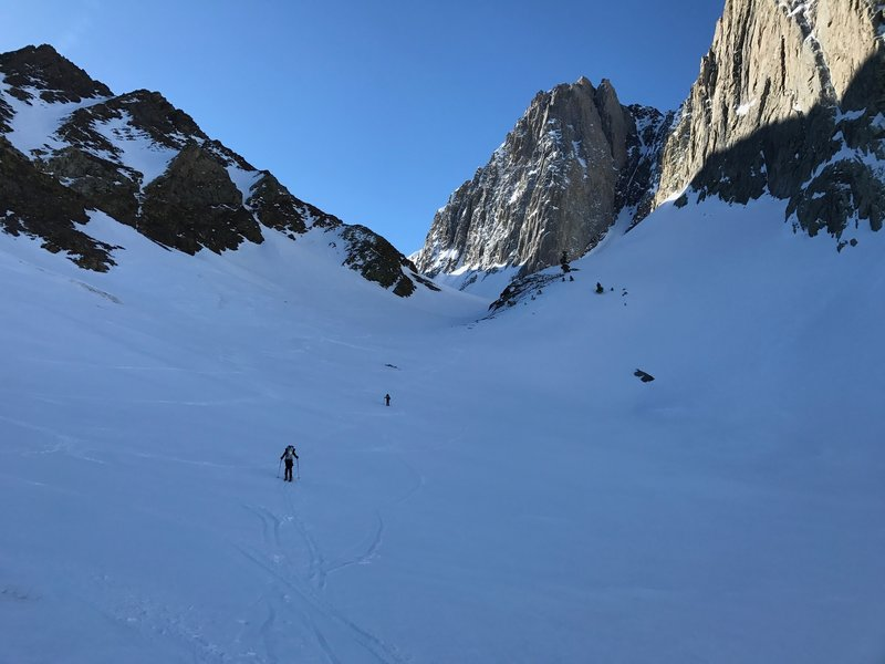 Ascending the chute at 9 am. Had to use crampons because snow was packed hard.