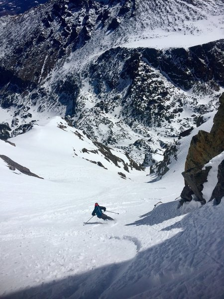 Sam cruising down Cross Couloir.