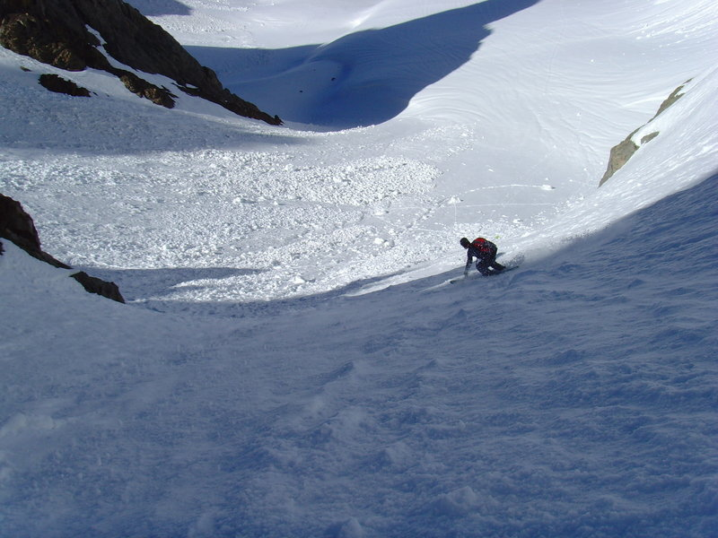 A skier carves down Breakfast Couloir.