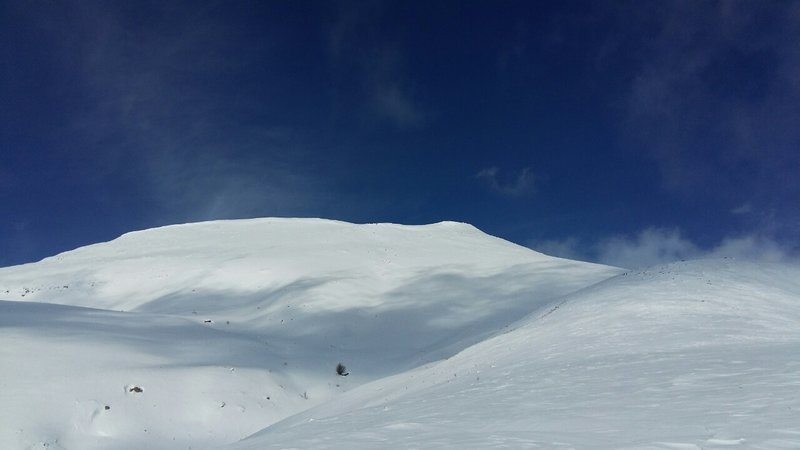 Mount Teghenis rises above the skin track.