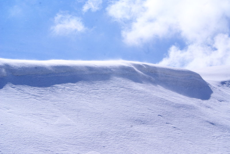 A cornice forms along a ridge of Mount Ara.
