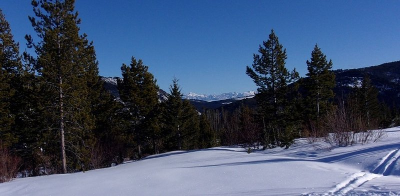 View SE to Absaroka Range (Black Mountain on left, Mt Cowan on right) from big switchback at 2.05 miles
