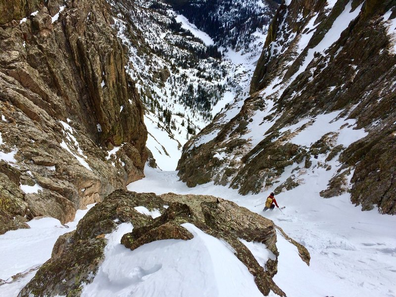 Approaching the crux of Dragontail, Emerald Lake is far below.