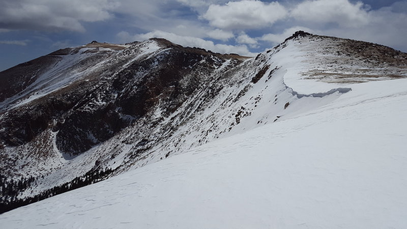 North side of the ridge above cornice bowl, facing south. Easiest descent is downhill from this location, and steeper descents can be found as you approach the cornice