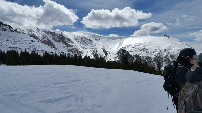 Taken near the summit of the Pikes Peak Ski Area, facing northwest. The Cornice Bowl is visible on the right with Little Italy just to the looker's left. Cornice collapses are common, so use caution in this area.