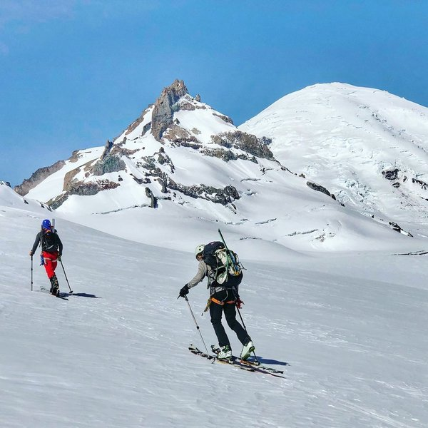 Skinning up towards Little Tahoma with Mt. Rainier looming large.