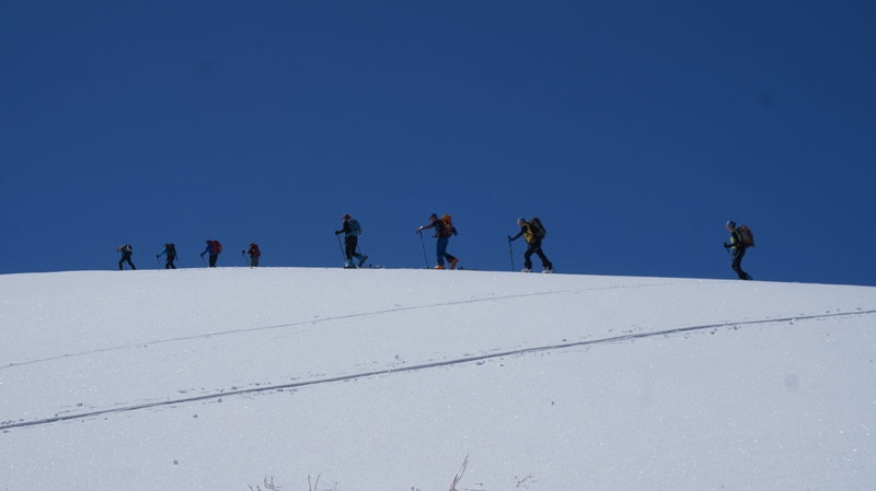 Skiers on the peak of Tsaghkunyats sierra