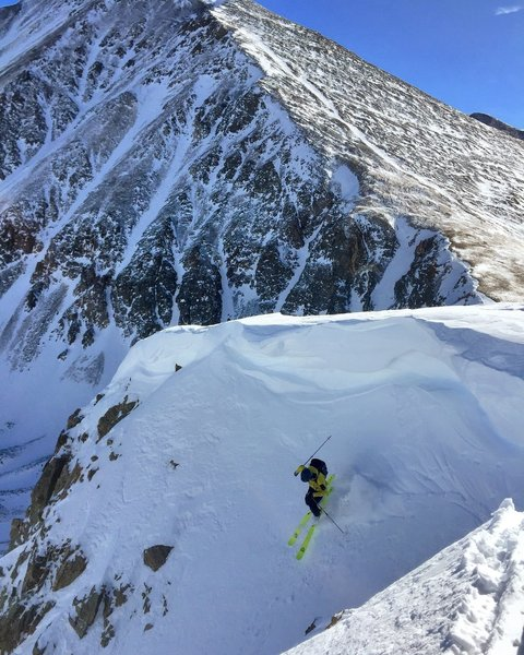 Dropping into Grizzly Couloir after traversing under the cornice.