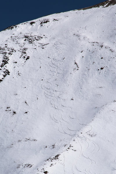 Snowboard tracks on the mountain known locally as Dog Peak after a rare Spring storm left a deep snowpack on the west side of Wheeler's north ridge, which is usually windblown and scoured down to the rocks.