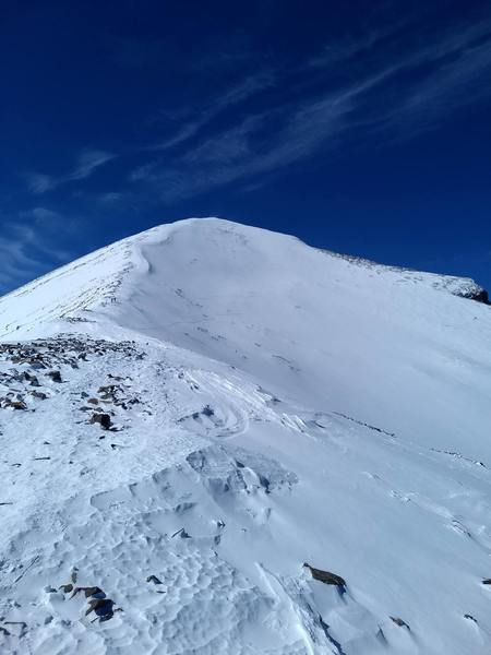 A view of the Upper East Bowl. Taken standing on the saddle, looking west towards the final summit ridge.