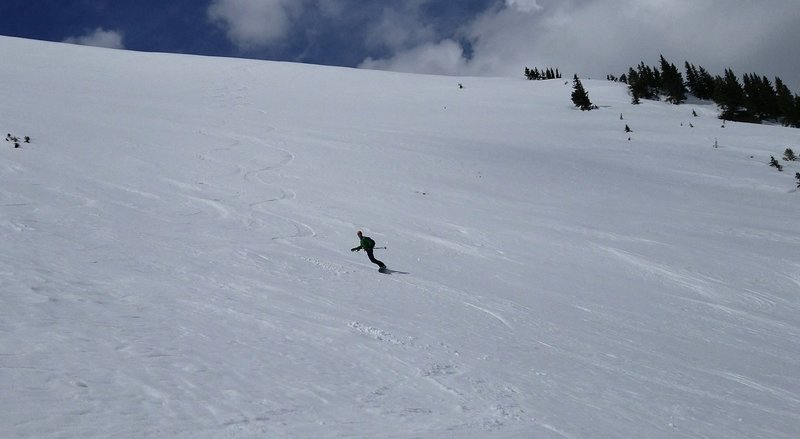 Carl Pluim skiing the far lookers right side of the Roberts Creek NE Headwall from the approach trail April 21st 2019, Berthoud Pass