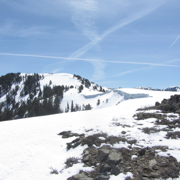 Skin away from the dirt/rocks, yes, but don't skin too close to the edge of the cornice line!
