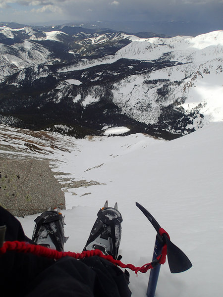 Looking down from the top of the Grand Couloir. Monarch Ski Area is visible in the background.