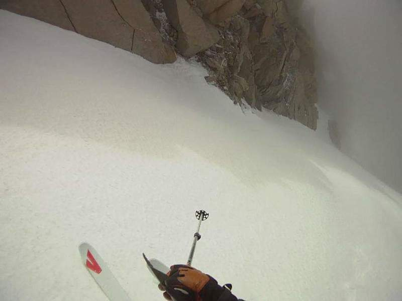 Skiing the top pitch of south couloir