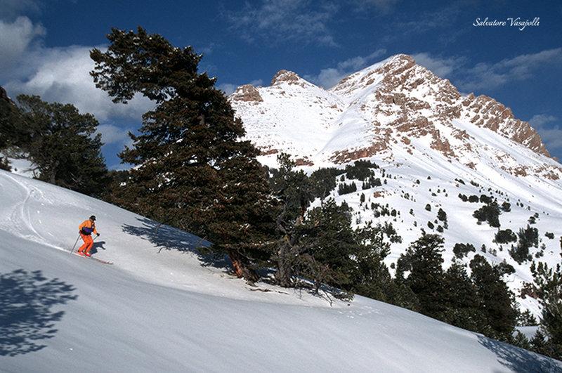Dan Jones skis spring snow below Sphinx Mountain.