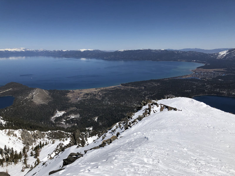 View from Tallac summit facing South Lake Tahoe. Photo taken during early Spring conditions (end of March, 2021).