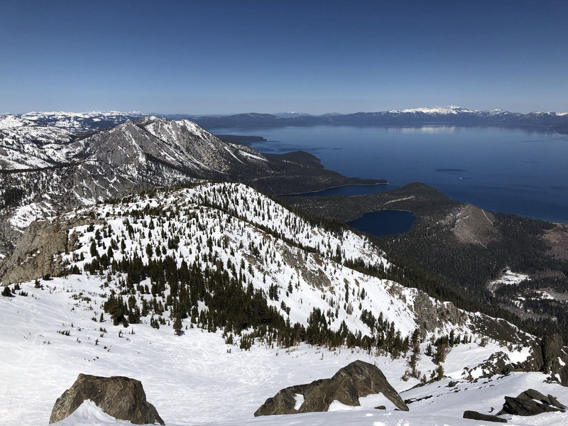 View from Tallac Summit toward Emerald Bay and Cascade Lake. Photo taken during early Spring conditions (end of March, 2021).