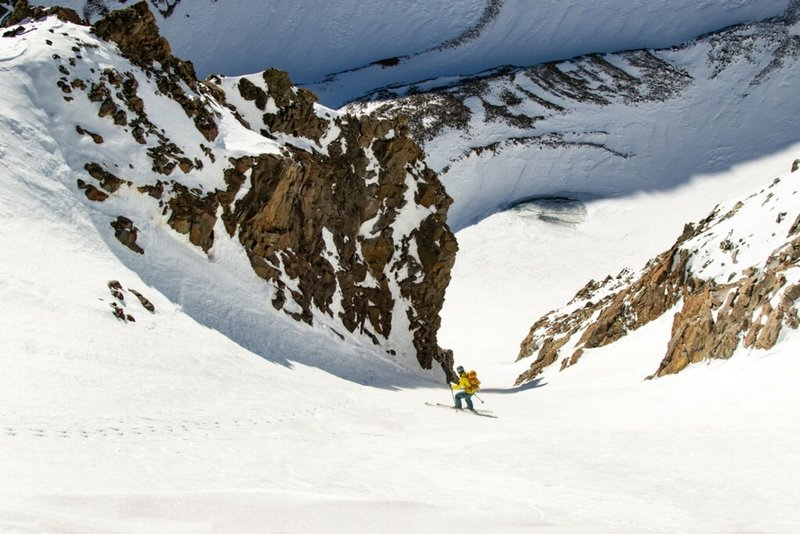 Skiing down Conundrum Couloir in hard conditions.