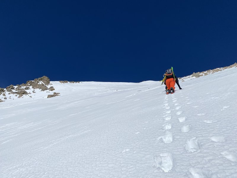 Alexis following the bootpack up the moderate angle slope.
