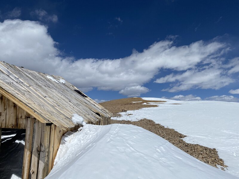 The summit is just past this old wooden building.